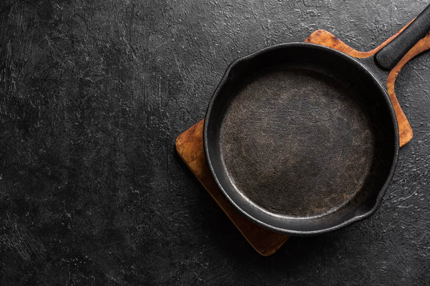 A newly washed skillet placed on top of a wooden cutting board, 6 Of The Best Ovenproof Skillets