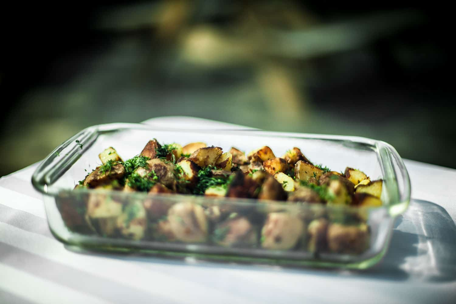 A delicious American cuisine on a pyrex glass casserole placed on a table outside to cool, Can Pyrex Go In The Oven?
