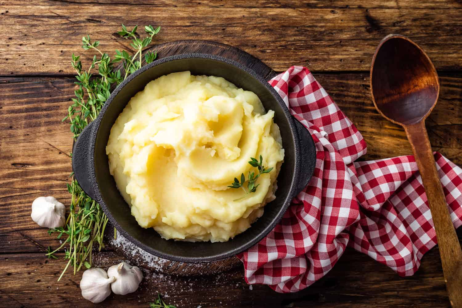 A delicious dish of mashed potato with dill on a table