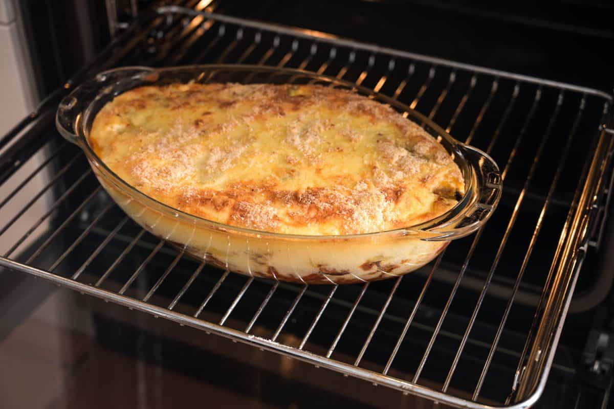 A delicious dish of traditional Moussake dish on a glass casserole freshly hauled out of the oven