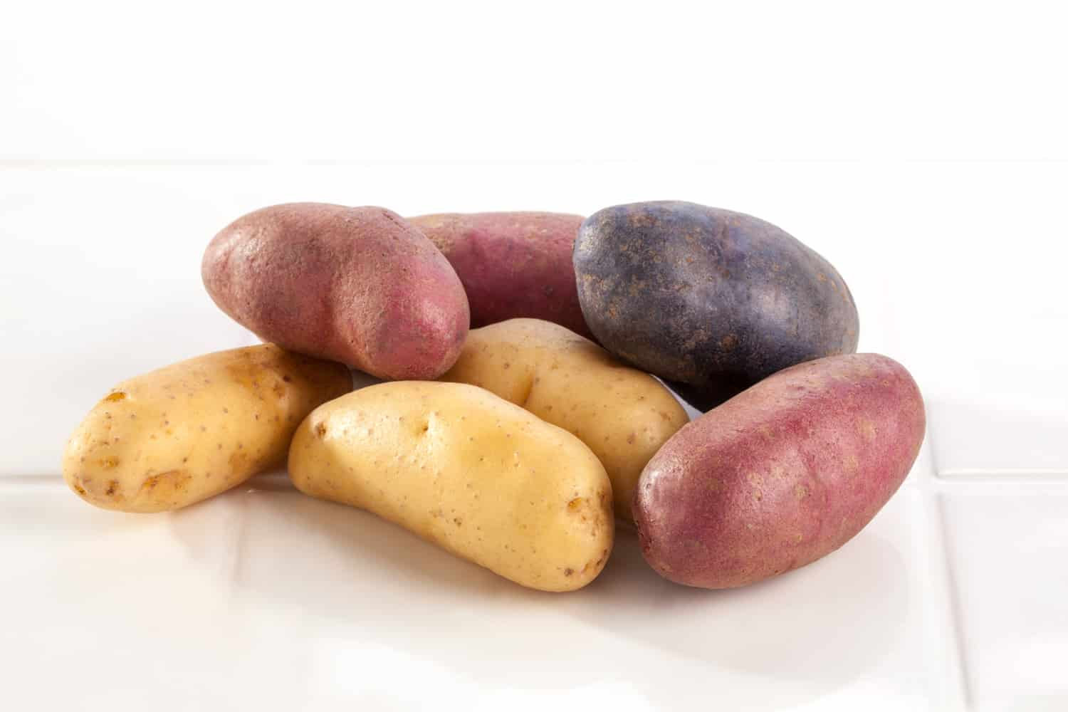 A group of multicolored Potatoes (about 6 ounces).