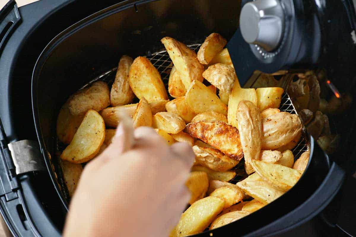 A homemade grilled potato inside an Air Fryer, How To Air Fry Potatoes - With 10 Tasty Recipes!
