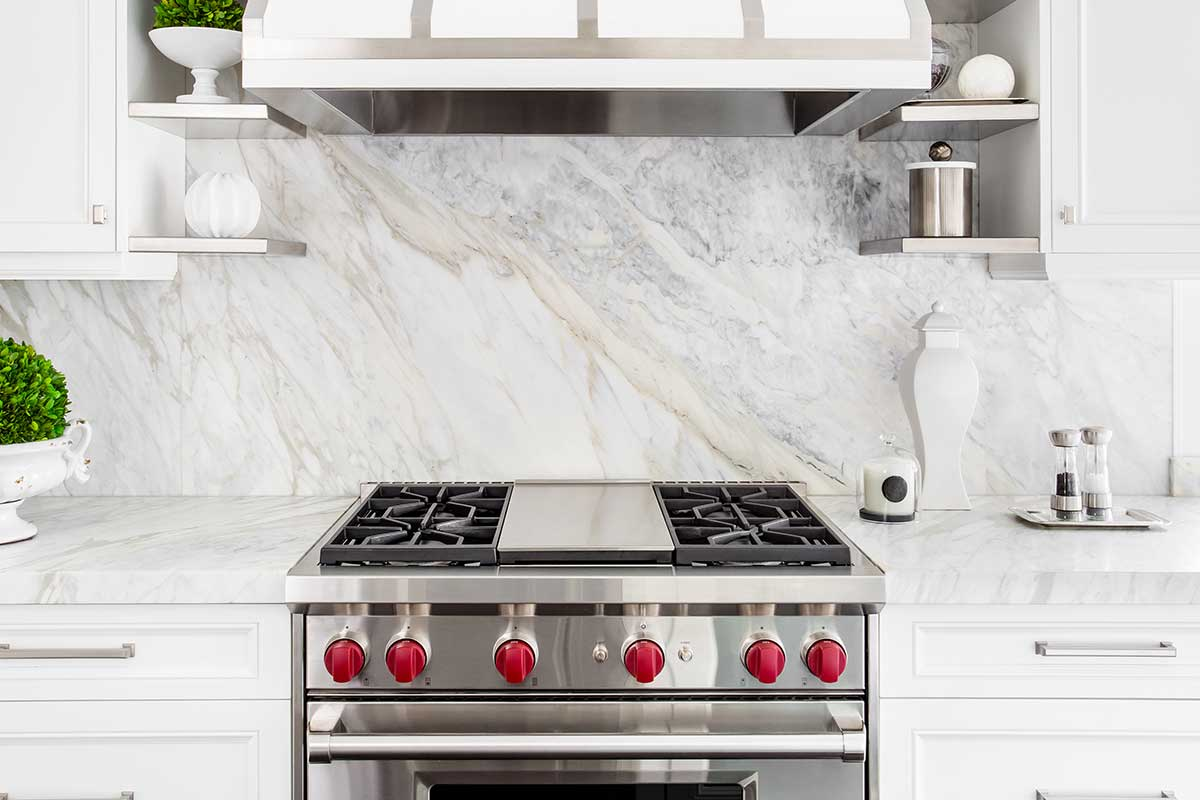 Bright classic white kitchen with gas range and marble backsplash, How Wide Should The Gap Be Between Slide-In Stove And Wall?