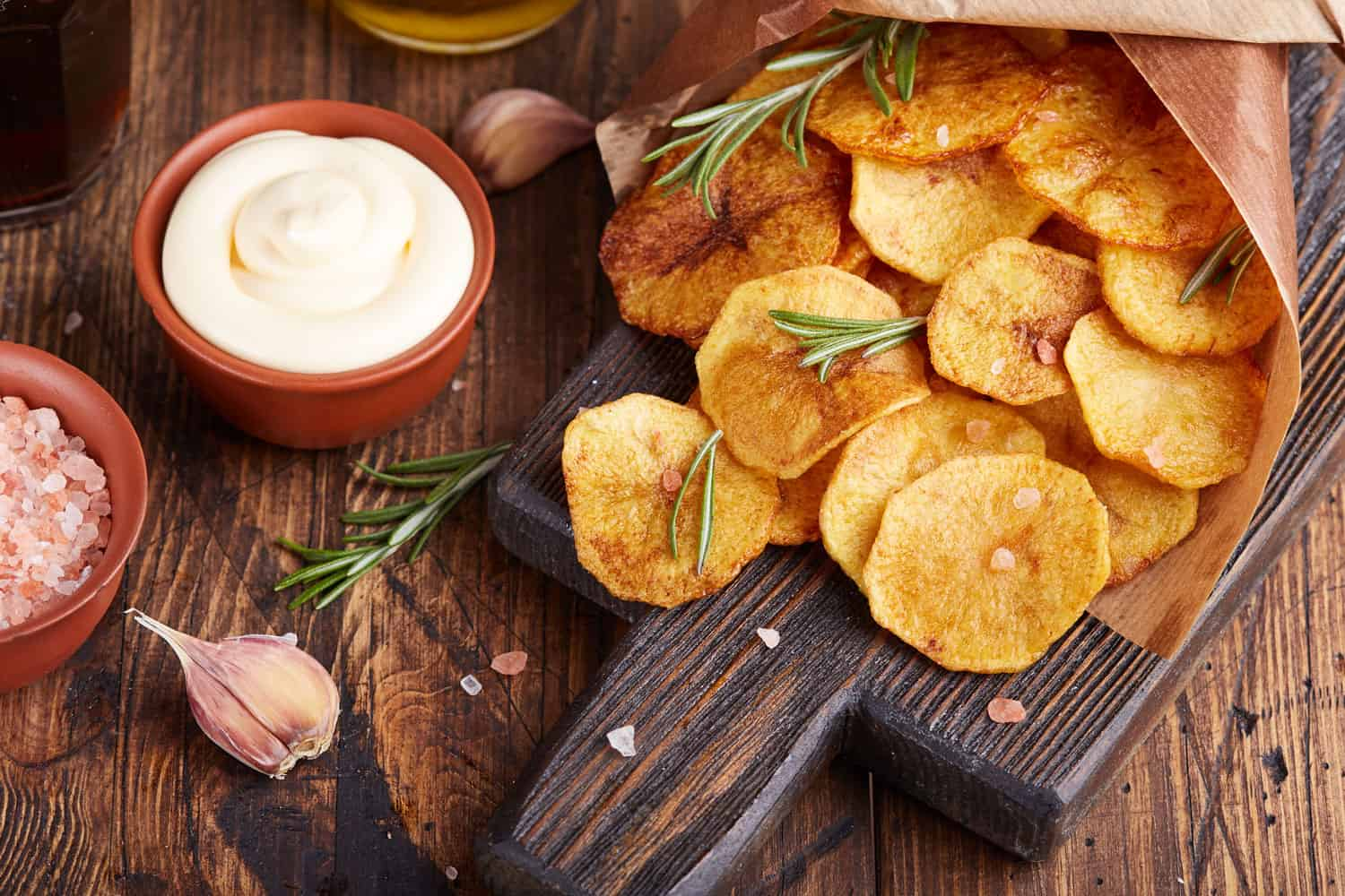Crispy potato chips. Slices of potato, roasted with sea salt and rosemary. Delicious snack served with sauce, What Potatoes Are Best For Chips?