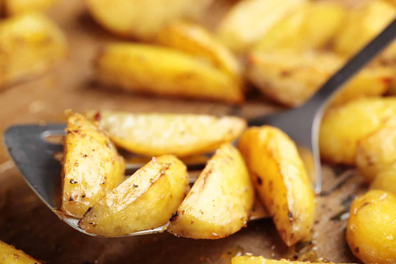 Deep fried evenly cut potatoes