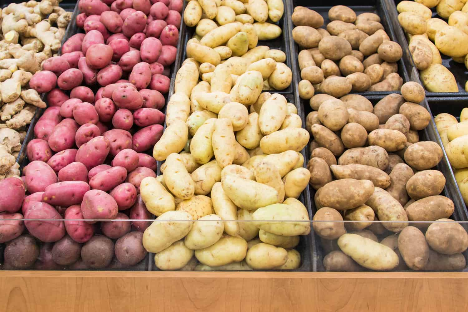Different varieties of potatoes on vegetable trays