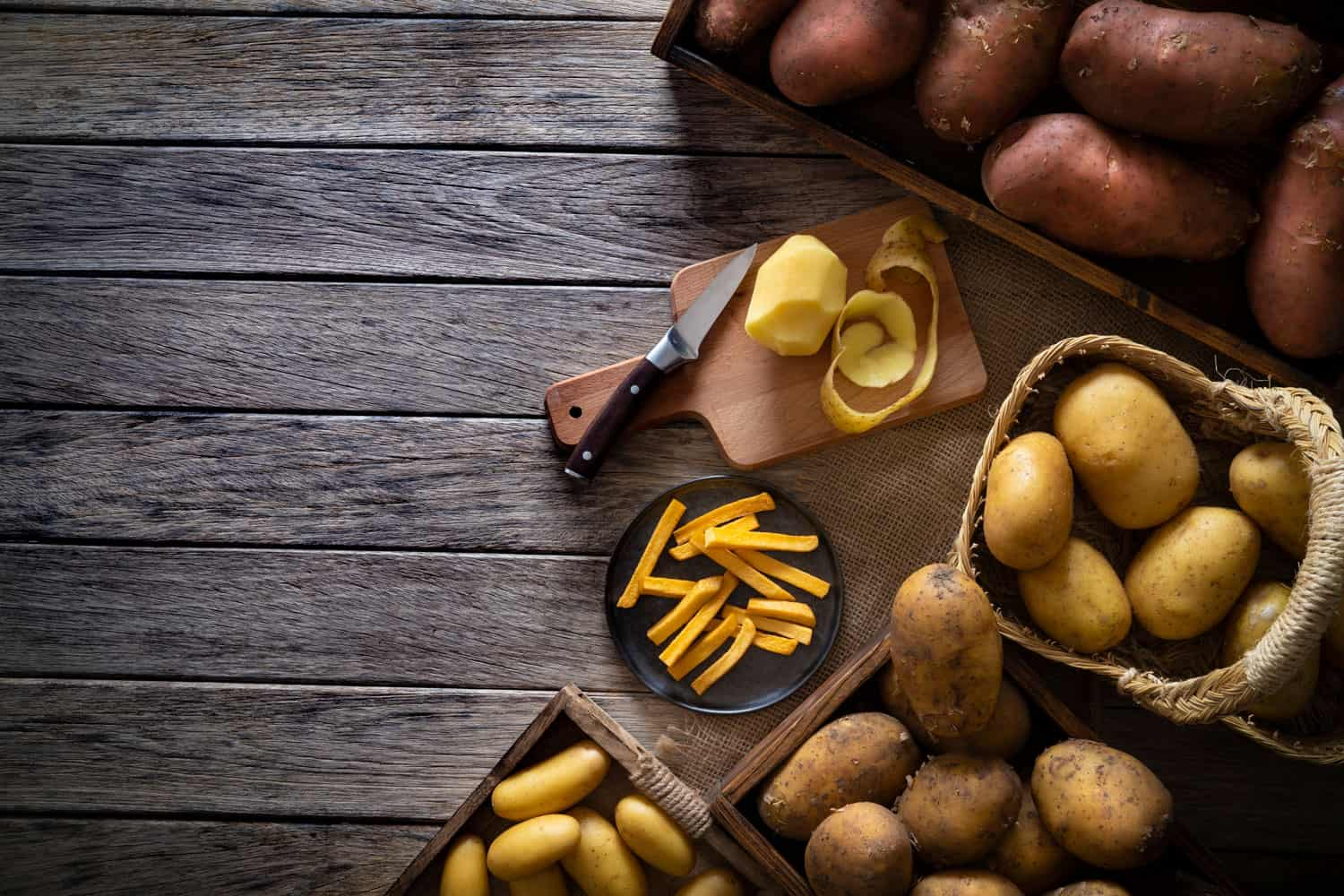 Different varieties placed on baskets on top of a table, Should You Keep Potatoes In The Fridge?
