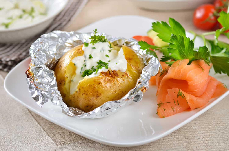 Hot jacket potato with sour cream and smoked salmon