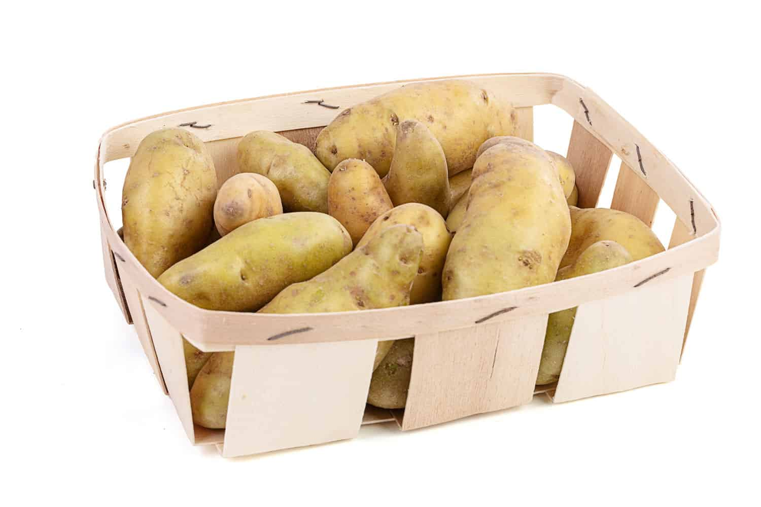 Potatoes placed on a tray on a white background