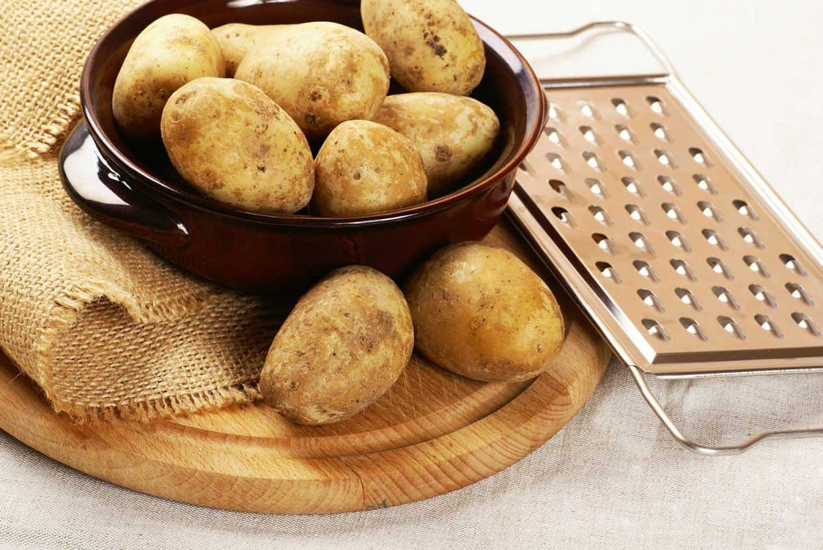 Potatoes with grater on the side