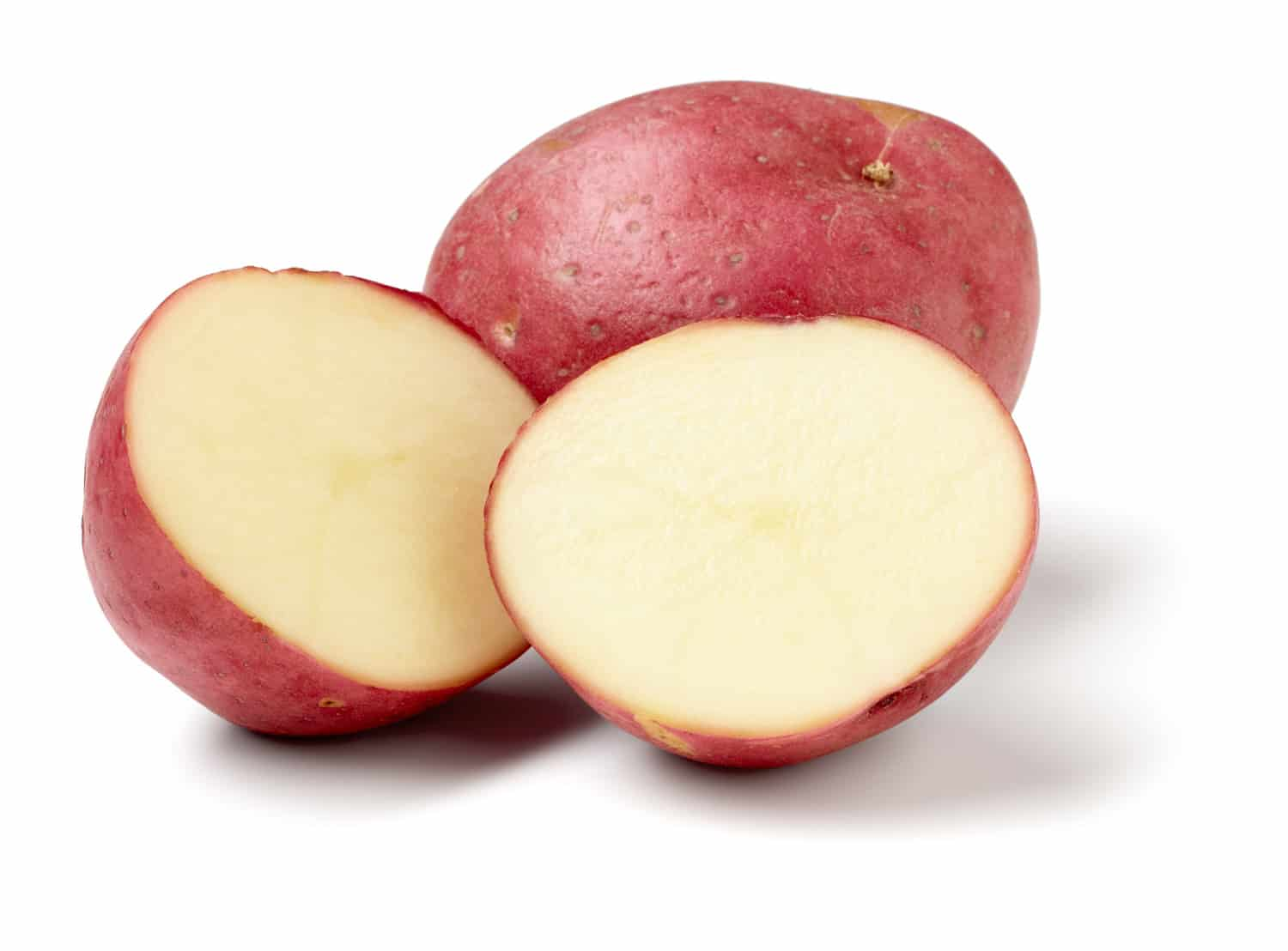 Red potatoes isolated on white background, larger files include clipping path. Color corrected, exported 16 bit depth, retouched and saved for maximum image quality.