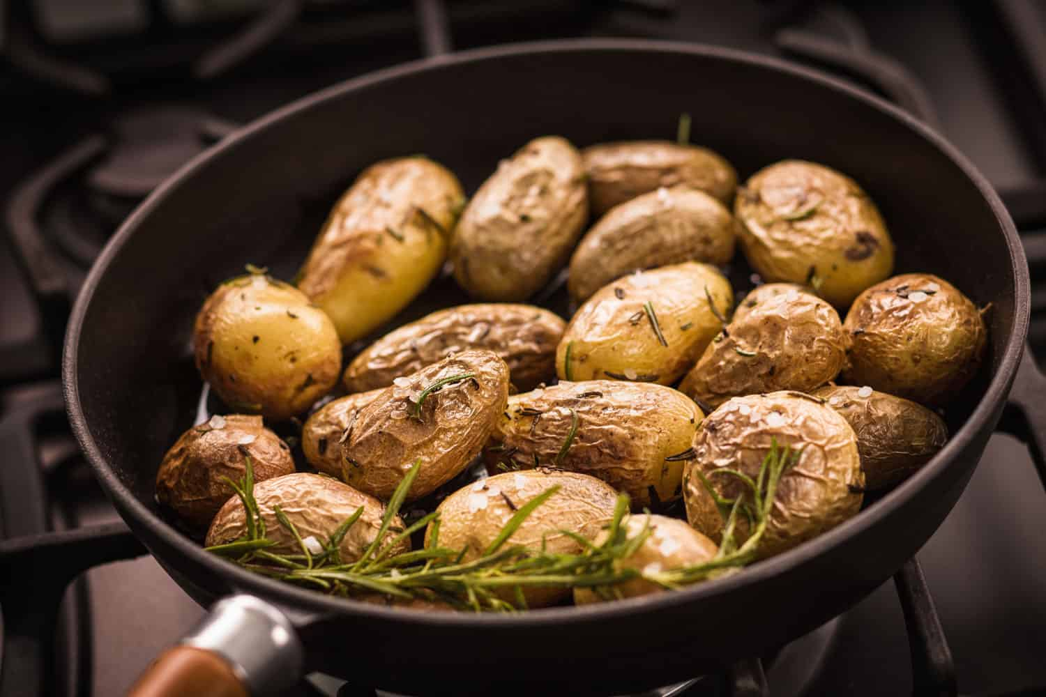 Roasted potatoes on a pan with rosemary for Aroma