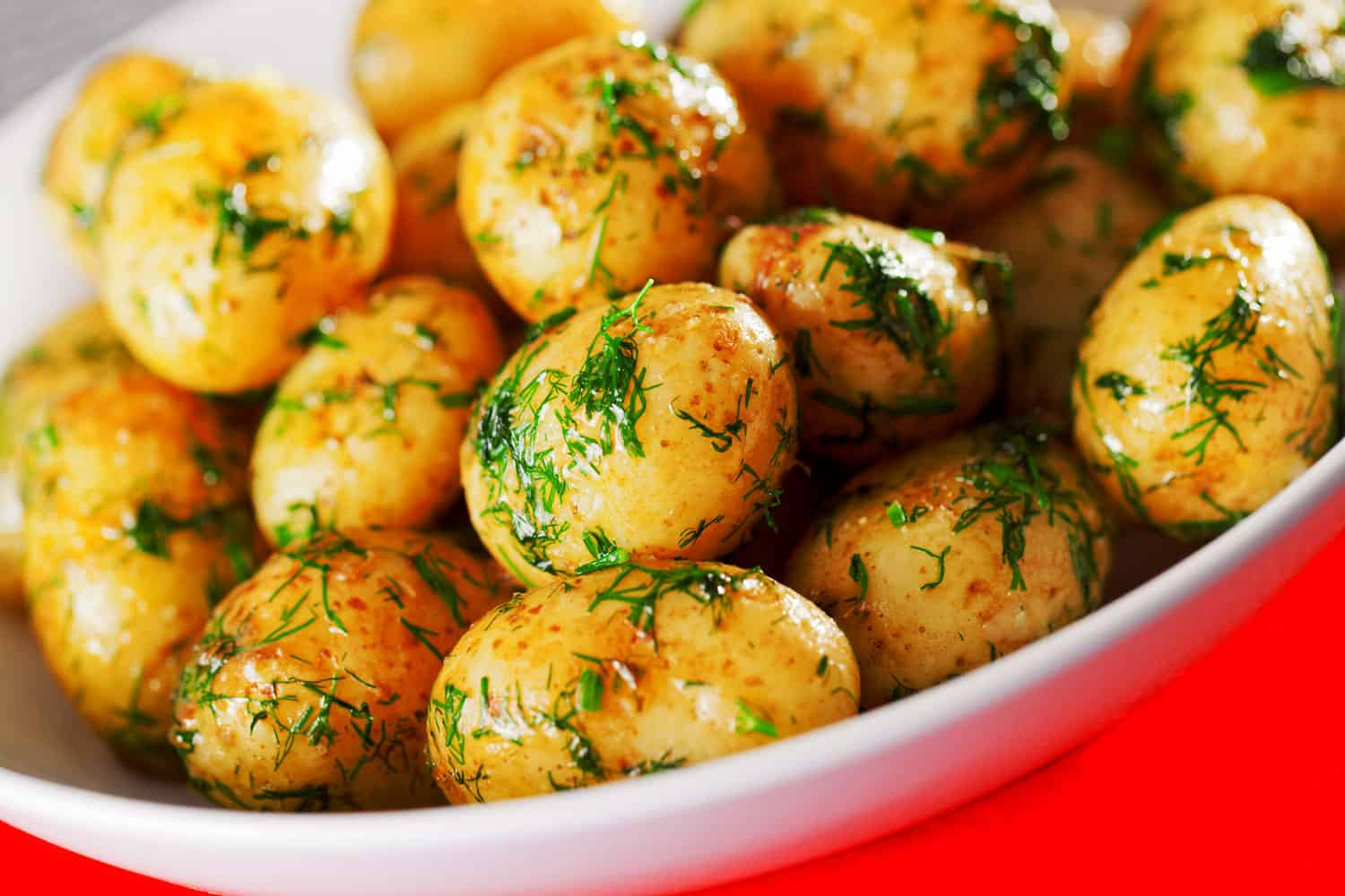 Sauteed potatoes with dill in a plate ready-to-eat