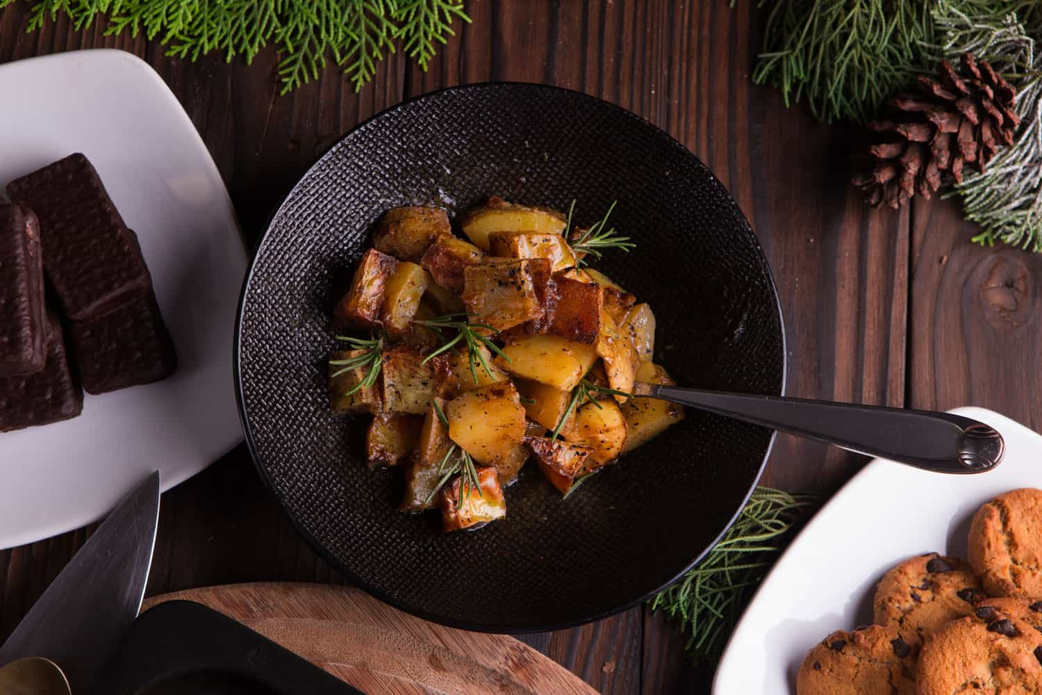 Sauteed sweet potato salad on black bowl on brown wooden background, How To Properly Sauté Potatoes - With 3 Yummy Recipes!