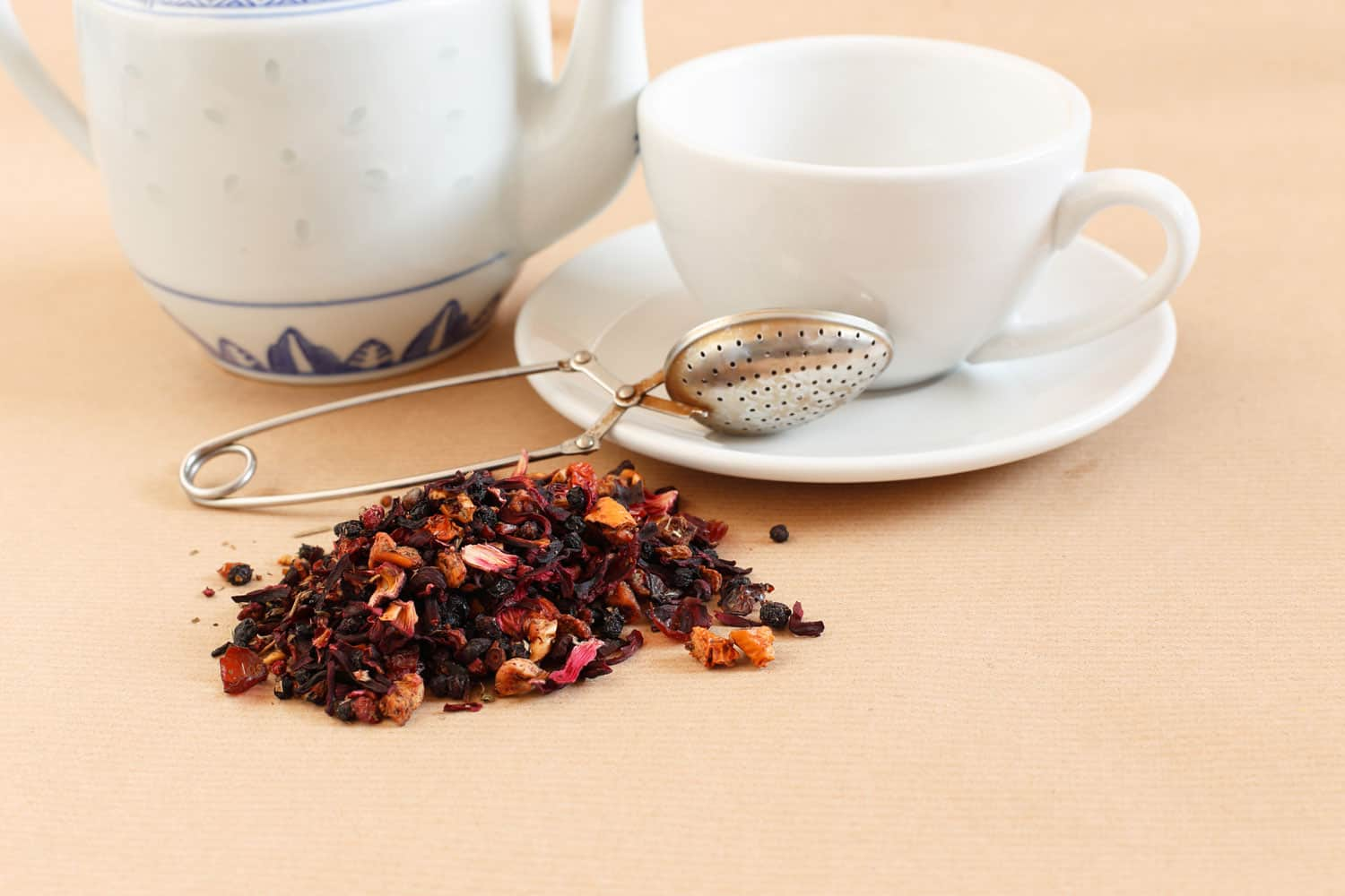 Teapot, tea cup and tea leaves ready to prepare a refreshing drink