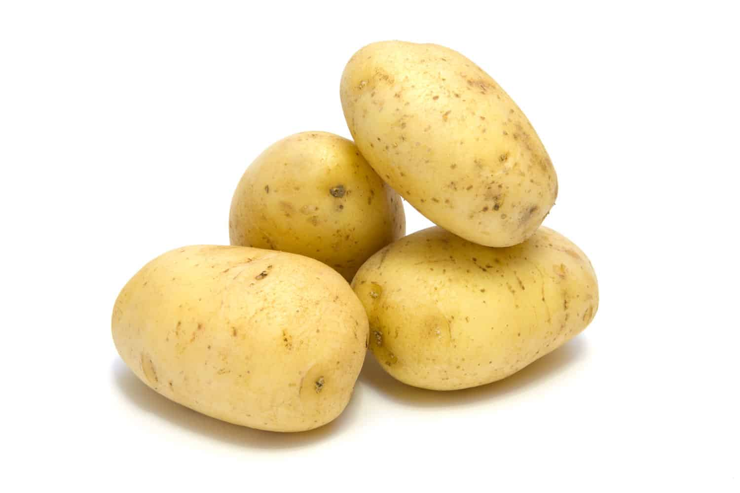 Up close photo of potatoes on a white background