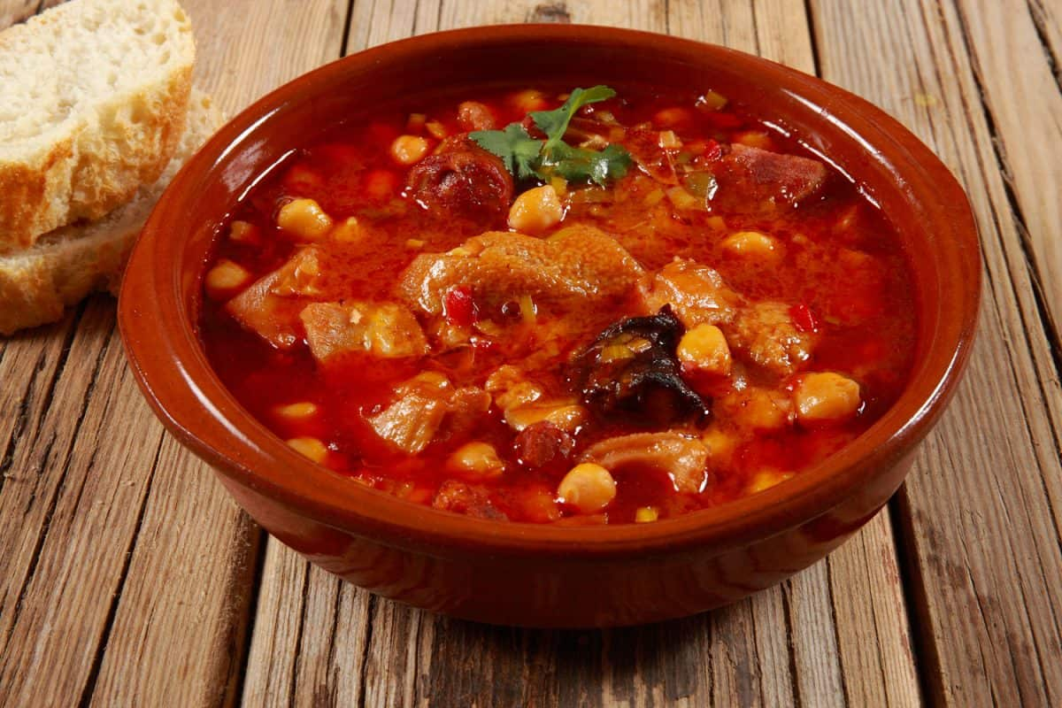 A delicious casserole with beef stew on a wooden table