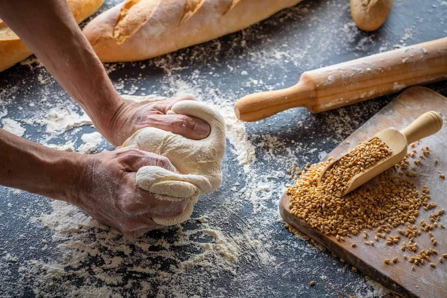 Baker man hands breadmaking kneading bread dough, How Long To Knead Bread [By Hand And In A Mixer]
