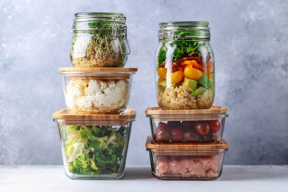 Different kinds of vegetables and bean products inside glass container