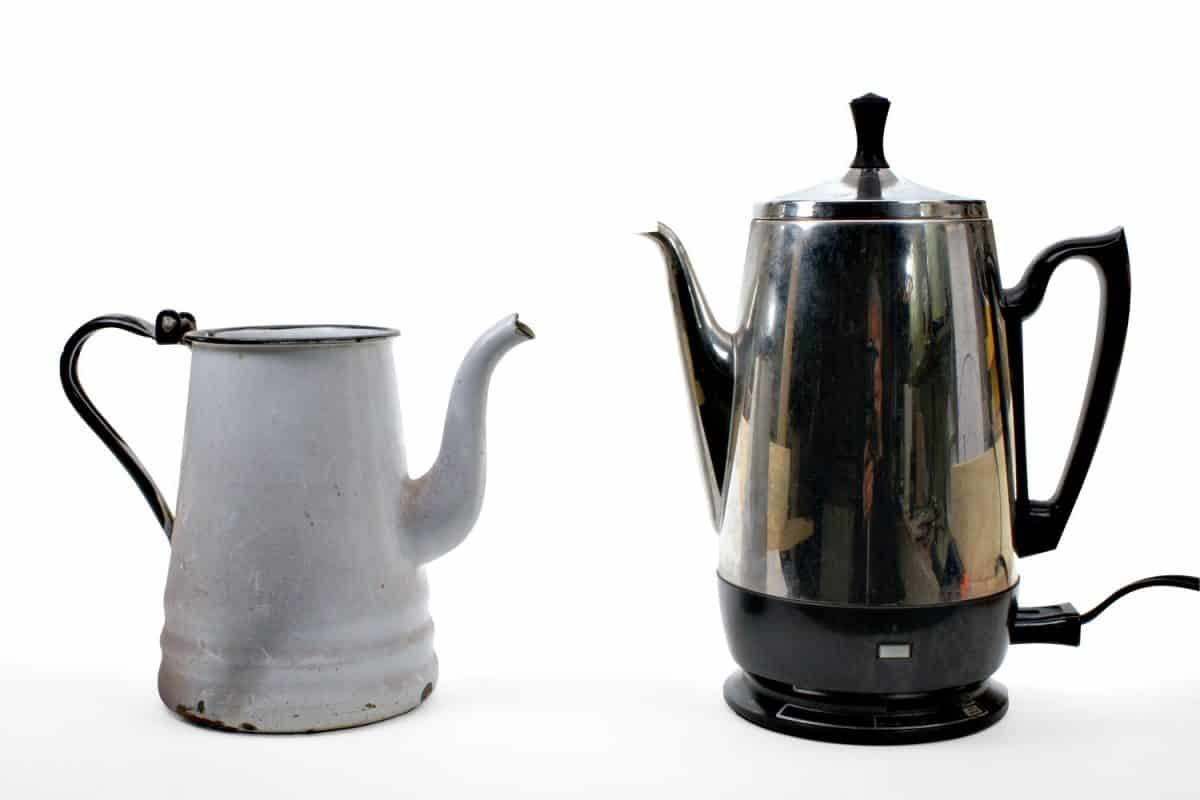 Old and new coffee makers on a white background
