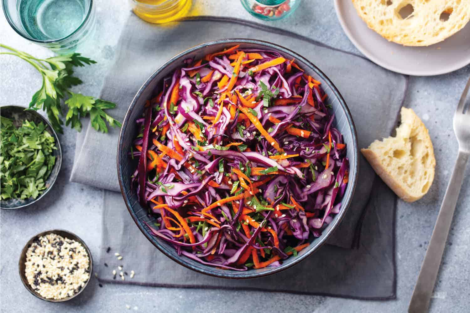 Red cabbage salad, Coleslaw in a bowl. Grey background