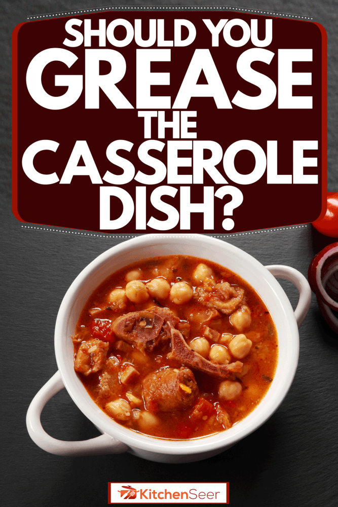 A casserole with beef stew on a gray table, Should You Grease The Casserole Dish?