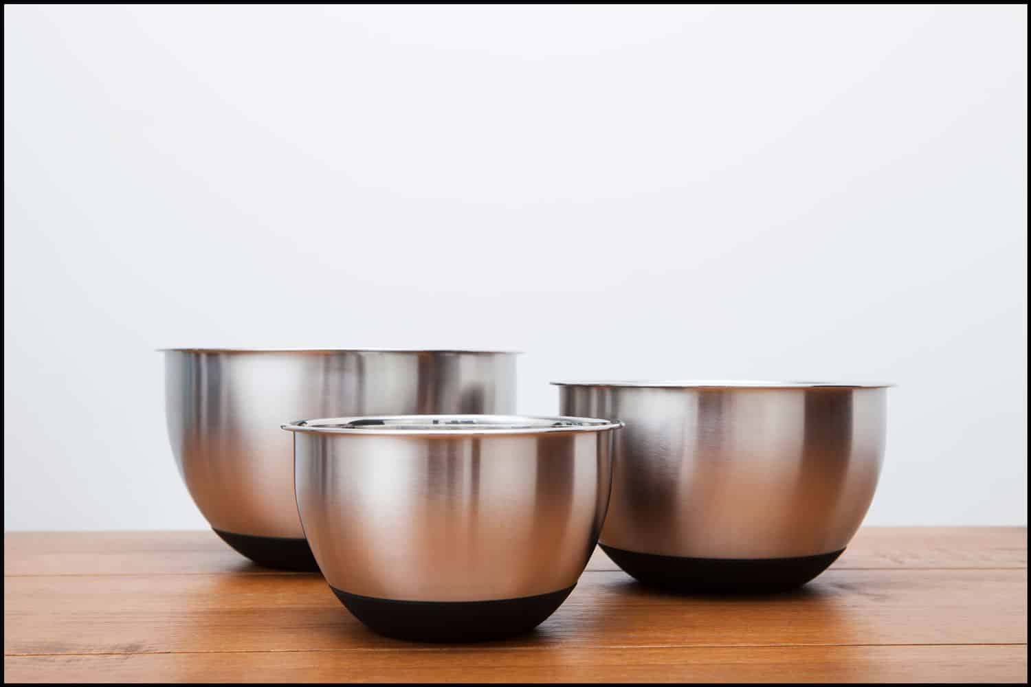 Three different sized silver coloured kitchen mixing bowls, When Should You Not Use Metal Mixing Bowls?