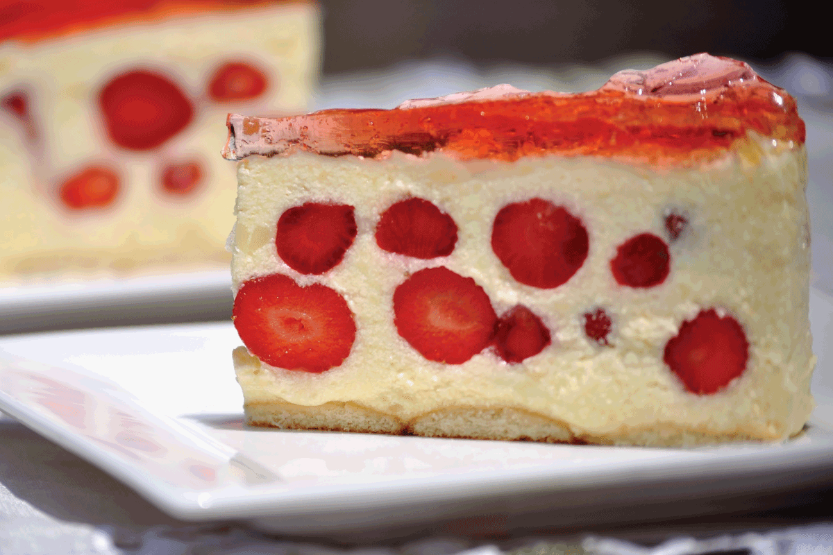 Close up of two pieces of strawberry- vanilla cream pie with strawberry jello. How To Properly Store A Cheesecake