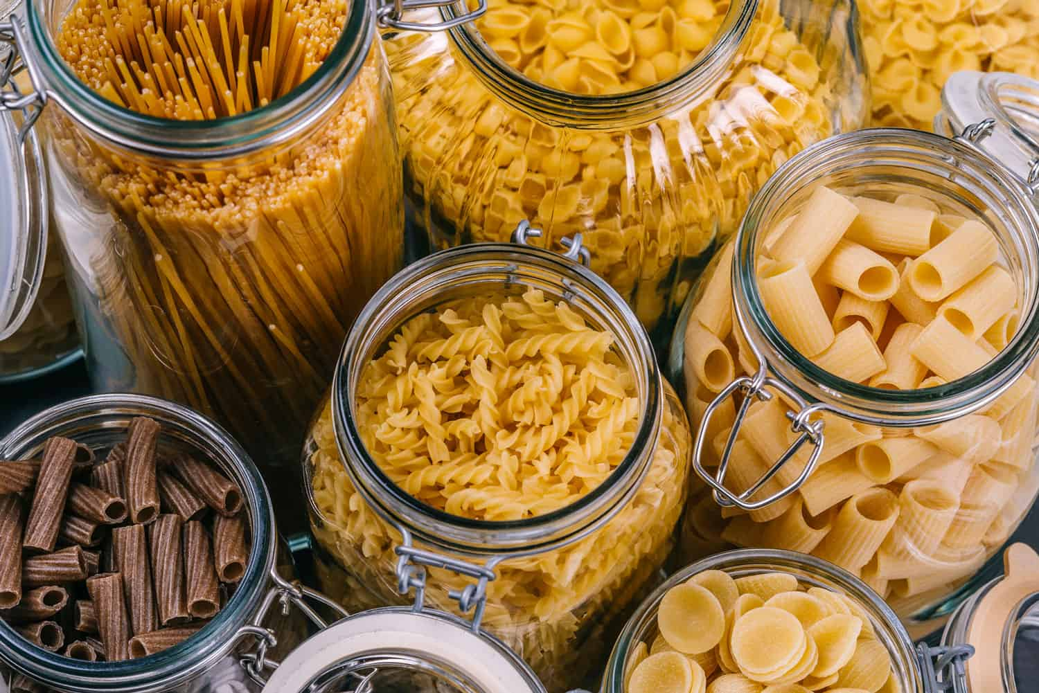 Photo of different pasta types in large glass jars