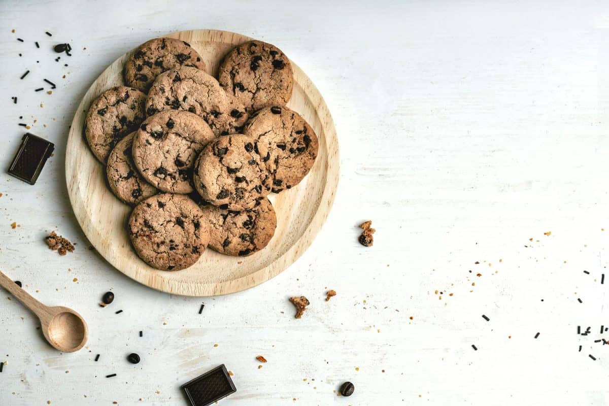 Can You Make Cookies Without Butter?,Plate of artisan cookies with chocolate chips on a white background