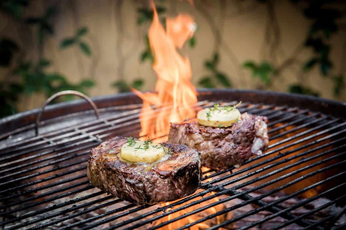 Two huge rump steak cuts grilled with butter melting on top of the steak, Should You Cook Steak In Butter Or Oil?