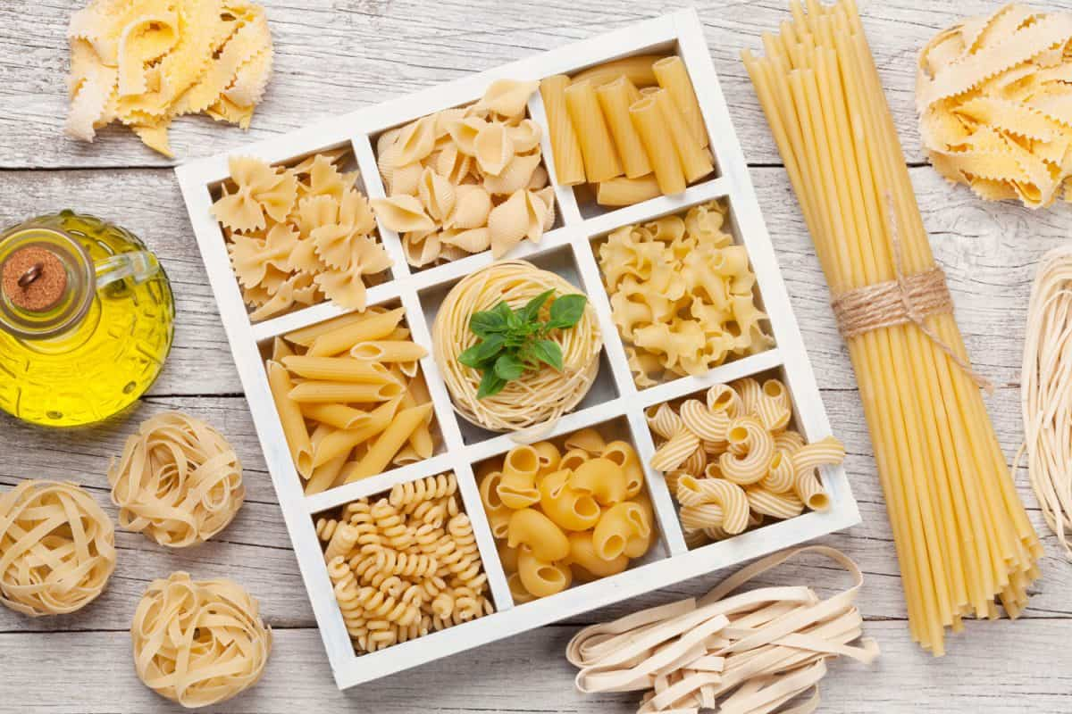 Various pasta in wooden box. Top view flat lay, Can You Eat Raw Pasta And Noodles?