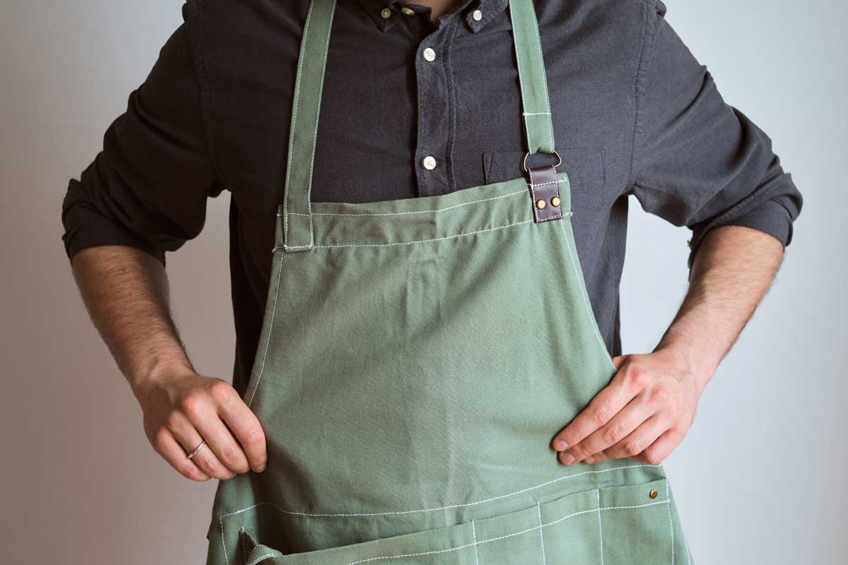 A man in a kitchen apron, When Should You Take Off Your Apron?