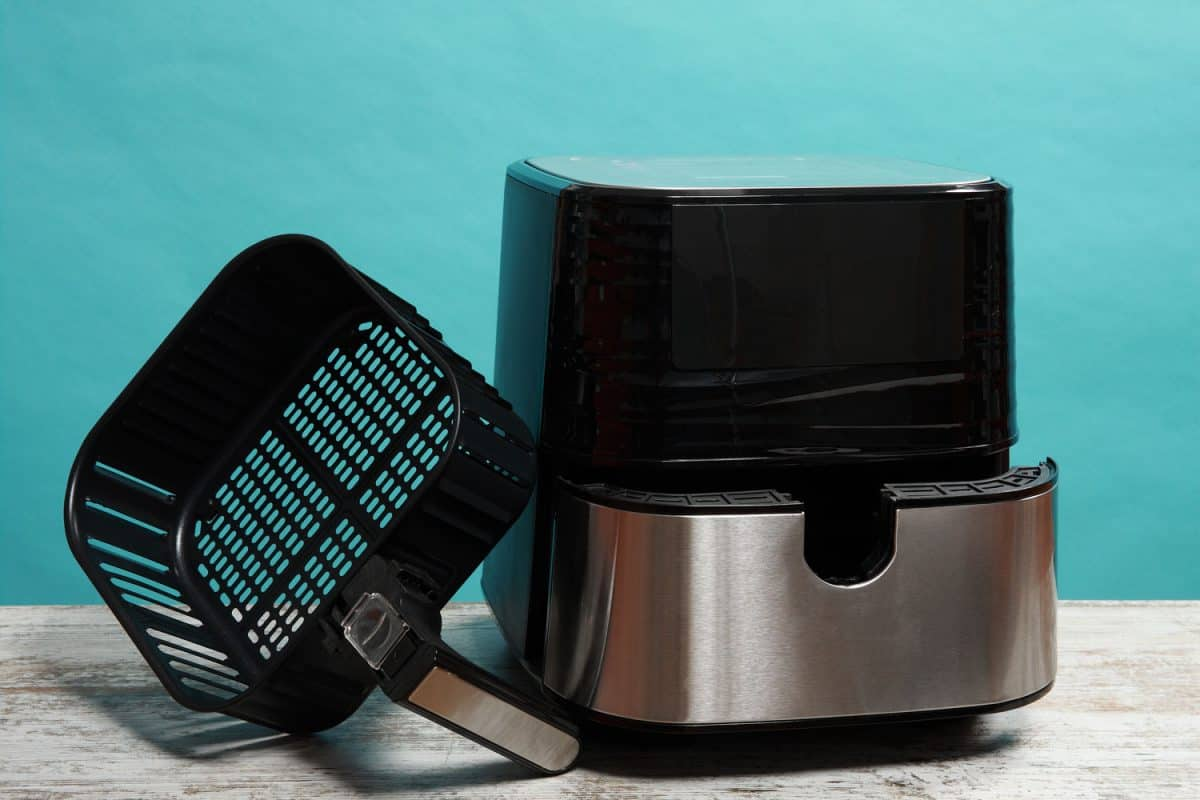 A photo of an Air fryer on a light blue background, Can You Use Flour In An Air Fryer?
