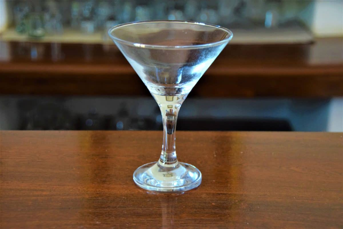 An empty martini glass on bar interior detail