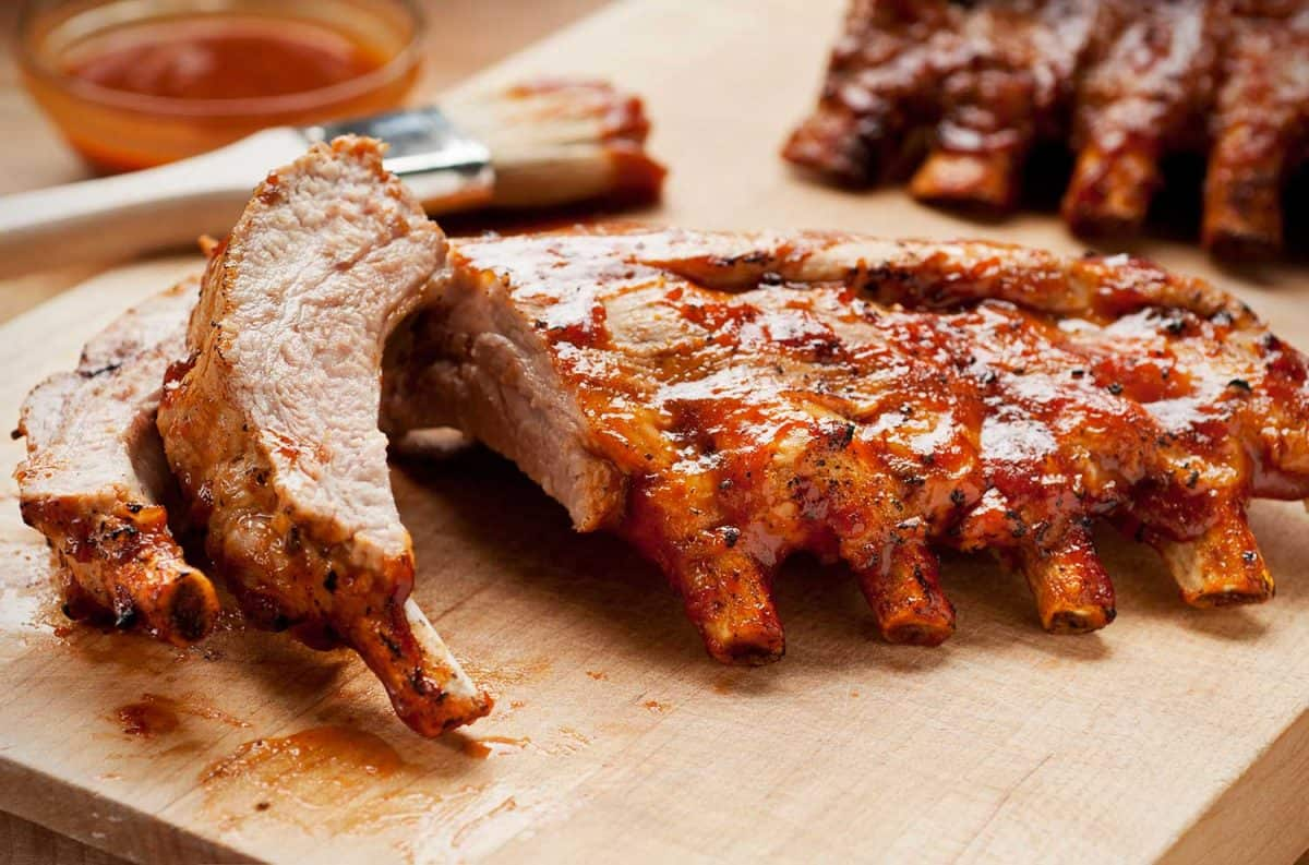 Barbecue ribs with sauce on a cutting board