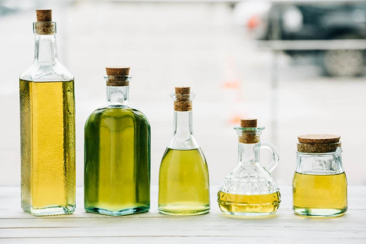 Different kinds of cooking oil inside different sizes of glass jar