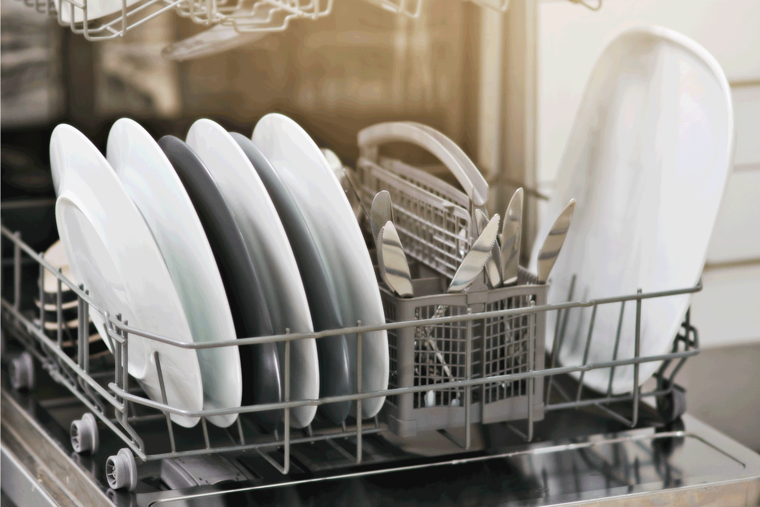 Dirty dishes no more stacked on a dishwasher tray