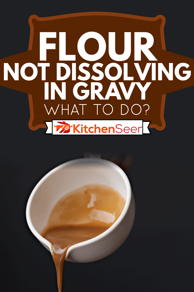 An extreme close up horizontal photograph of a hand holding a gravy boat and pouring some beef or turkey gravy, Flour Not Dissolving In Gravy - What To Do?