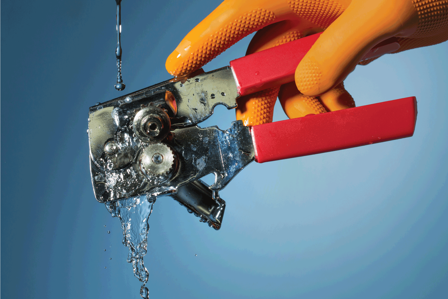 Rinsing a can opener on running water