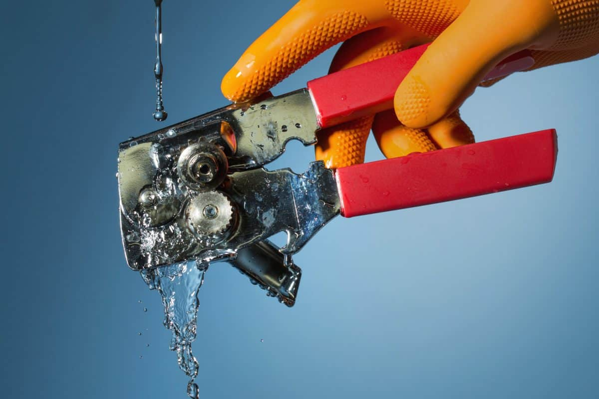 Rinsing a can opener. Action is stopped in this high speed photograph.