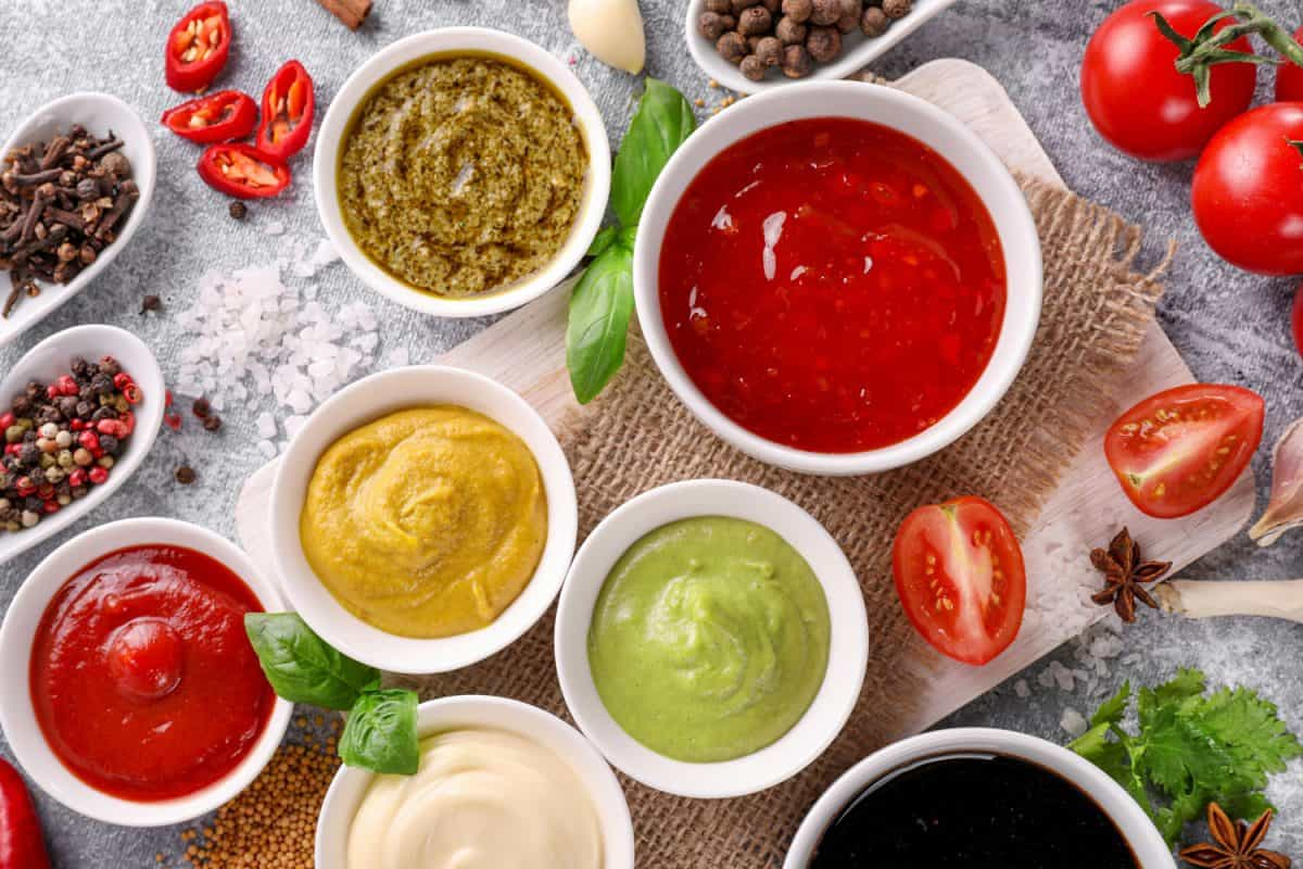 Set of sauces in ramekins and spoons on stone background, Do Ramekins Come In Different Sizes?