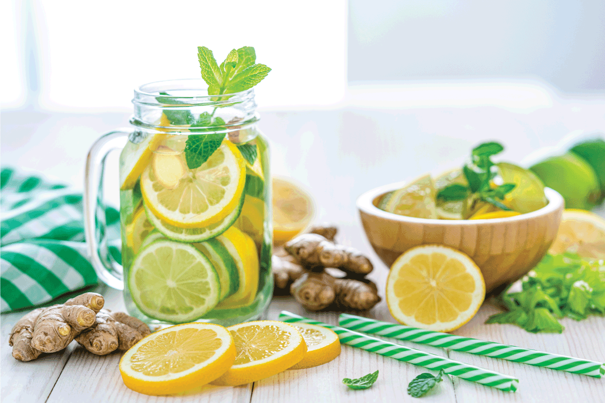 Some-lemon-slices,-ginger-roots-and-two-green-and-white-drinking-straws.-Does-Microwaving-Lemons-And-Lime-Make-Them-Juicier