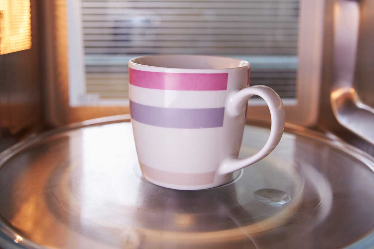 Warming cup of coffee inside microwave oven, Can You Put Mugs In The Oven?