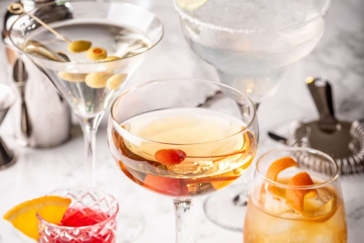 collection of classic cocktails, negroni, old fashioned, manhattan, margarita, martini glasses, How Big Are Cocktail Glasses?