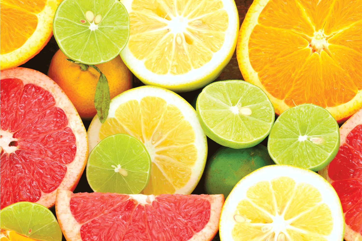 fresh citrus fruits cut up and placed on a table