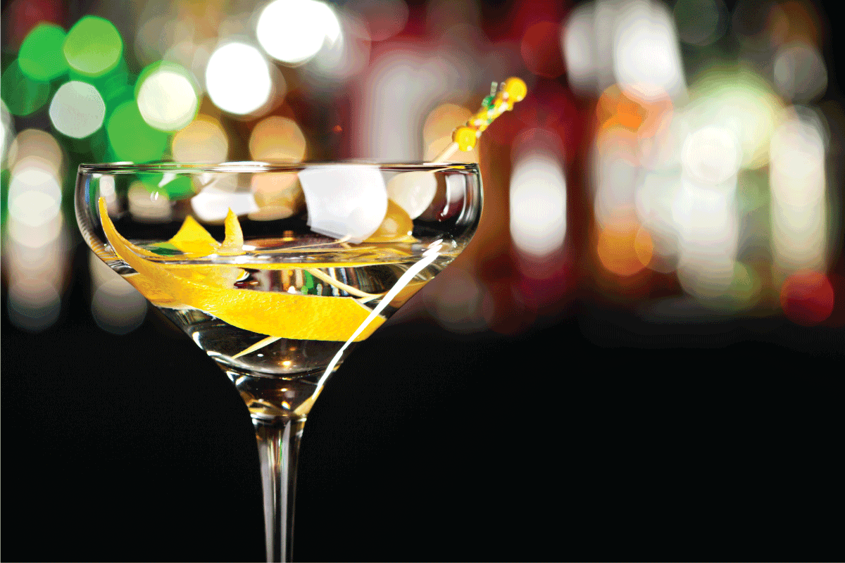 martini glass with drink and orange peel on a bokeh background. What Is The Right Size For A Martini Glass