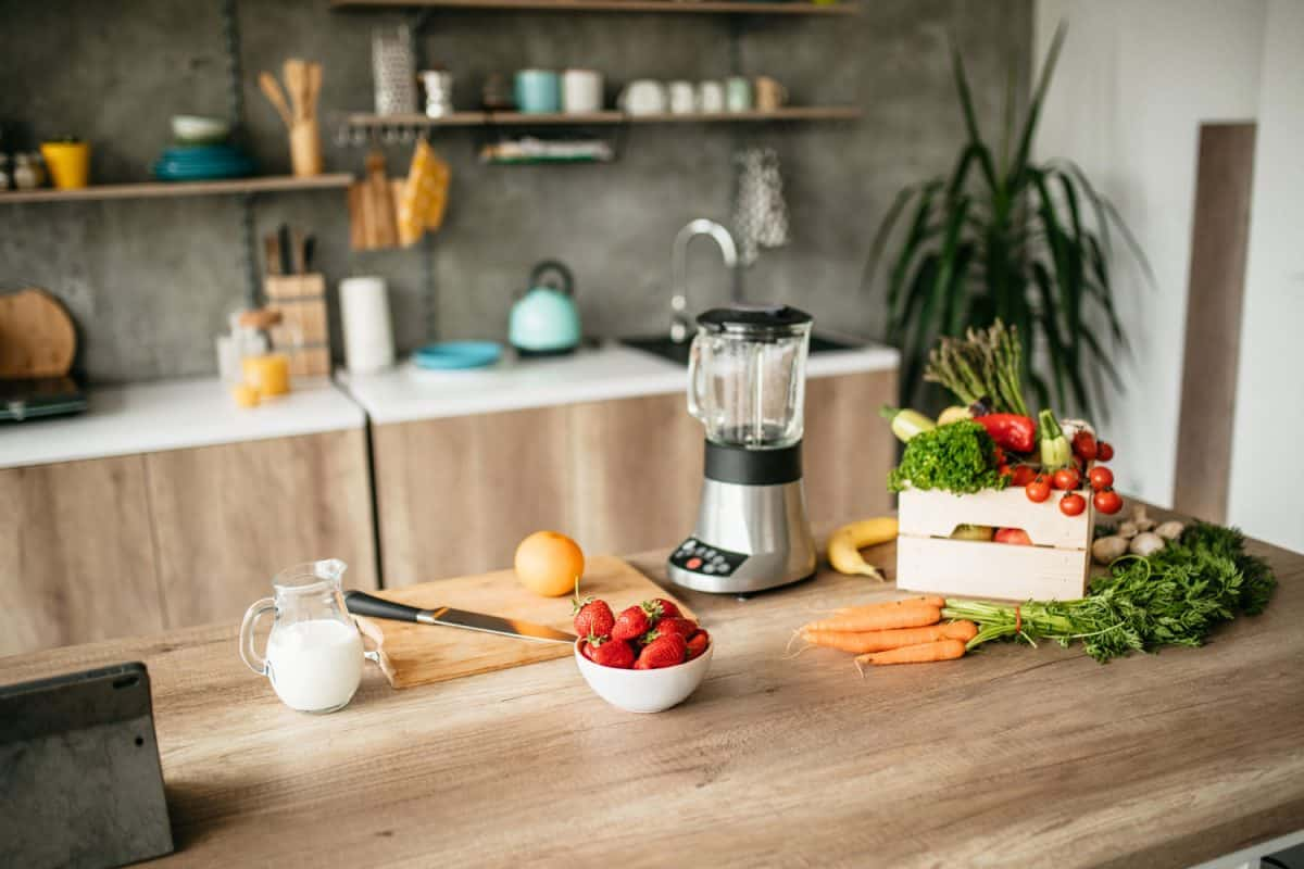 A blender and Healthy food standing on the kitchen table, Can A Blender Be Used As A Grinder?