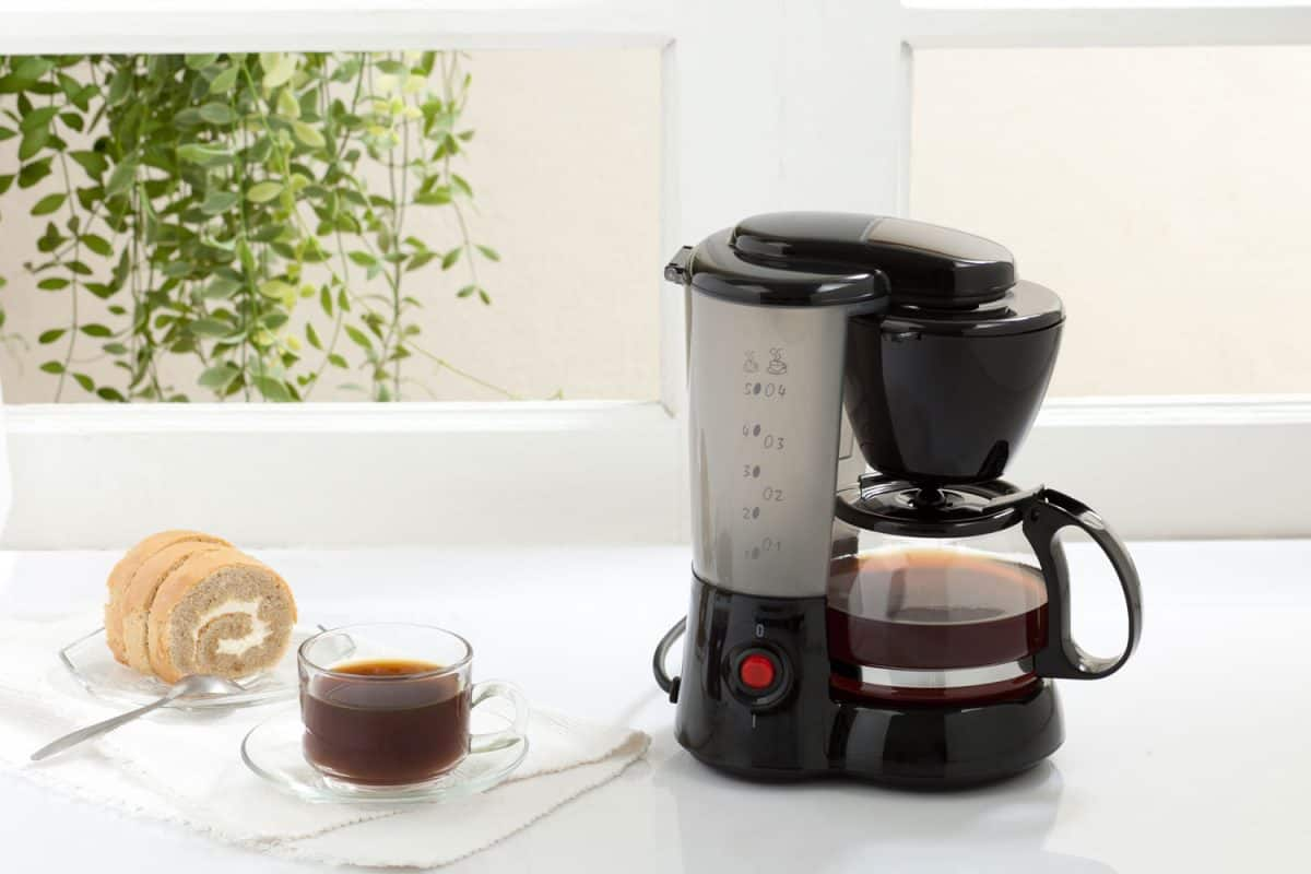 A coffee maker placed on the table with small slice of bread on the side, Is Keurig Coffee Weaker Than Drip Coffee?