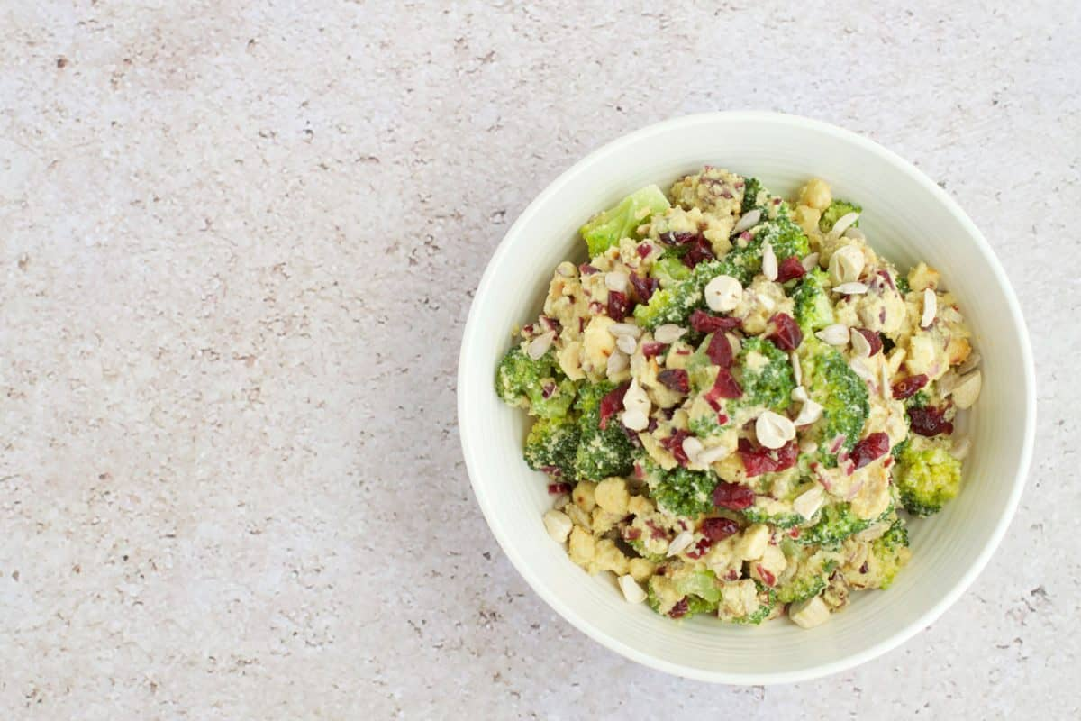 A delicious bowl of broccoli salad on the table